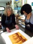 Mauren and Jini Grinwald pulling a print